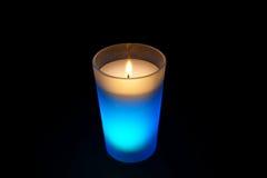 Burning light blue candle Royalty Free Stock Photography