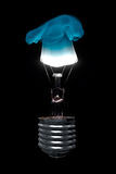 Burning Light Bulb with Blue Flame Royalty Free Stock Image