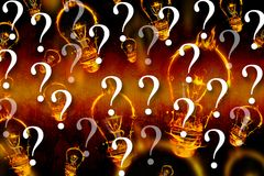 Burning light bulb graphics with question marks. Composite of burning light bulb graphics with question marks Royalty Free Stock Photo