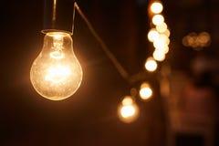 Burning light. Light bulb close-up. Garland. In the dark. stock photos