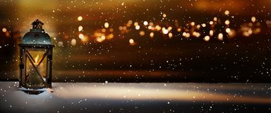 Burning light in a winter night royalty free stock images