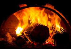 Burning lods in oven Royalty Free Stock Images