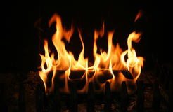 Burning log. Log burning in a mountain cabin Royalty Free Stock Images