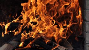 Burning log and fire. Fire flames with logs and dark background royalty free stock photo