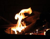 Burning Log in Hot Fire and Flames Royalty Free Stock Photos