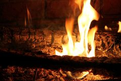 Burning Log in Hot Fire and Flames Stock Photo