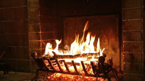 The fire is burning in the fireplace stock video footage