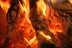 Burning logs in a chimney fire. Closeup of burning logs in a chimney fire Royalty Free Stock Photography