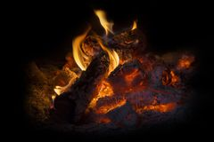 Burning logs closeup detail background Royalty Free Stock Photos