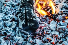 Burning logs and embers in the fire royalty free stock images