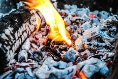 Burning logs and embers in the fire stock photography