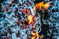Burning logs and embers in the fire stock image
