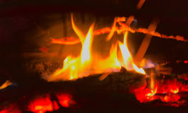 Burning logs at fire place Stock Images