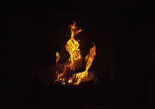 Burning Logs in Fireplace Royalty Free Stock Photos