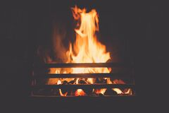 Burning Logs in Fireplace Royalty Free Stock Images