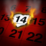 Burning Love. Valentines romantic date concept as a calendar page with a heart shaped burning paper on  February 14 of Saint Valentines day as a reminder and Stock Image