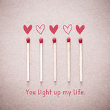 Burning love match with heart shape fire light with wording You light up my life valentine card Royalty Free Stock Photography