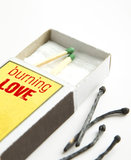 Burning love metaphor. Couple of matches in a box. Some burnt matches outside. Metaphor for nymphomaniac Stock Photo