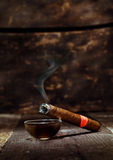 Burning luxury Cuban cigar Royalty Free Stock Photo