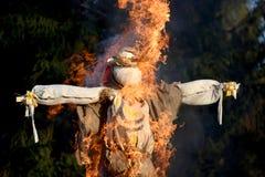 The burning Maslenitsa effigy Stock Photos