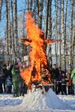 Burning of Maslenitsa Scarecrow in evening. Traditional burning of Maslenitsa Scarecrow on seeing Russian winter on last day of Shrovetide, March 3, 2016, Tula stock photo