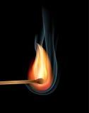 Burning match. On black background Stock Photos