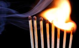 Burning Match. Sequence of burning match on black background stock image