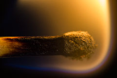 Burning match. The picture shows a close up of a burning match royalty free stock photography