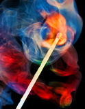 Burning match. And color smoke Stock Photos