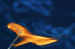 Burning match. A match during ignition Stock Image