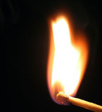 Burning match. A closeup of a burning match stock photo