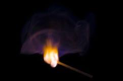 Burning match Stock Image
