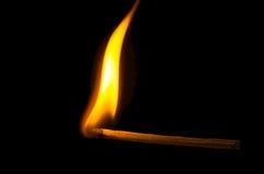 Burning match. On black background Stock Images