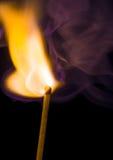 Burning match. On black background Royalty Free Stock Photo