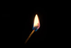 Burning match on a black background Stock Photography