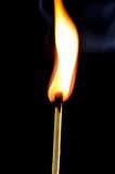 Burning match on black background Royalty Free Stock Photography