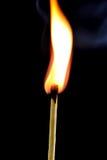 Burning match on black background Royalty Free Stock Photography