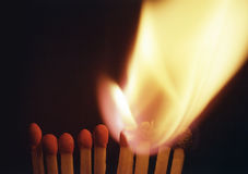 Burning match, chain reaction. Concept royalty free stock image