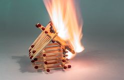 Burning match house Stock Photography
