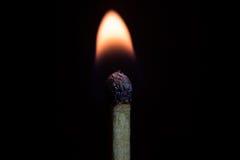 Burning match isolated on a black background, macro image. Royalty Free Stock Photography