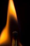 Burning match isolated on a black background, macro image. Stock Images
