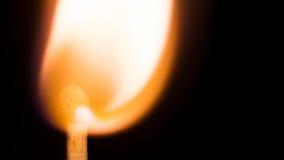Burning match isolated on a black background, macro image. Royalty Free Stock Photo