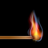Burning match over dark background Royalty Free Stock Images