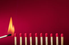 Free Burning Match Setting Fire To Its Neighbors Royalty Free Stock Photo - 30293275