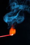 A burning match and smoke. A burning match with smoke coming out Stock Photos