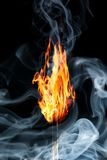 Burning match with the smoke Stock Photography