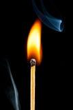 Burning match with smoke. Black background Stock Photo