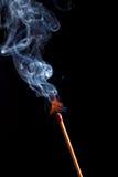 Burning match with smoke stock photos