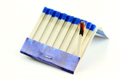 Burning Matchbook paper stick macro. Royalty Free Stock Images
