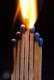 burning matches Arkivbild